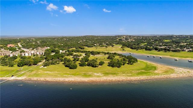 ONE OF A KIND WATERFRONT LOT ON LAKE TRAVIS!! This 59+ acre lot is located on its own peninsula ready for your private waterfront ranch, condos, hotels, apartments, etc with endless opportunities! Utilities are already located on the property & a concrete slab from a previous hotel that was removed. Approved in 2007 by the city of Lago Vista for 225 waterfront condos, 200-slip dry stack marina, on-shore restaurant/bar, spa/medical, retail & floating restaurant/bar, PLUS a 50-slip floating marina.