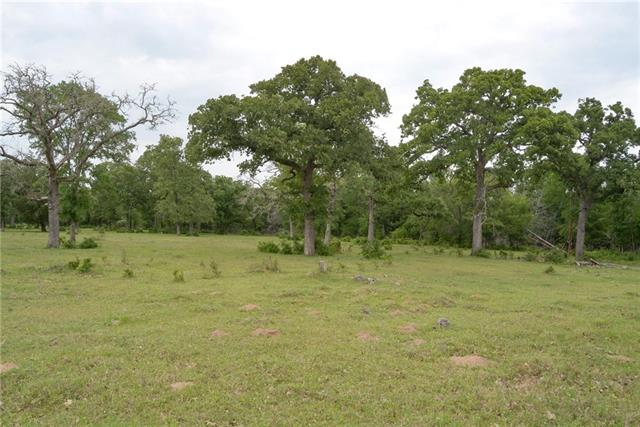 Beautiful oaks & pastures within a few miles of Bastrop City limits. Great corner lot with lots of road frontage. Nice level land w/ some rolling terrain. 100% fenced, some pole barns, tack shed, hay pen, corral. Well is used for cattle only currently, not guaranteed to be suitable for drinking water. Lots of wildlife, bow hunting there now. There were coal mines in the area and this land has had a few areas sink due to this, so this has to be disclosed to buyers.  Enjoy country life only mins to town!