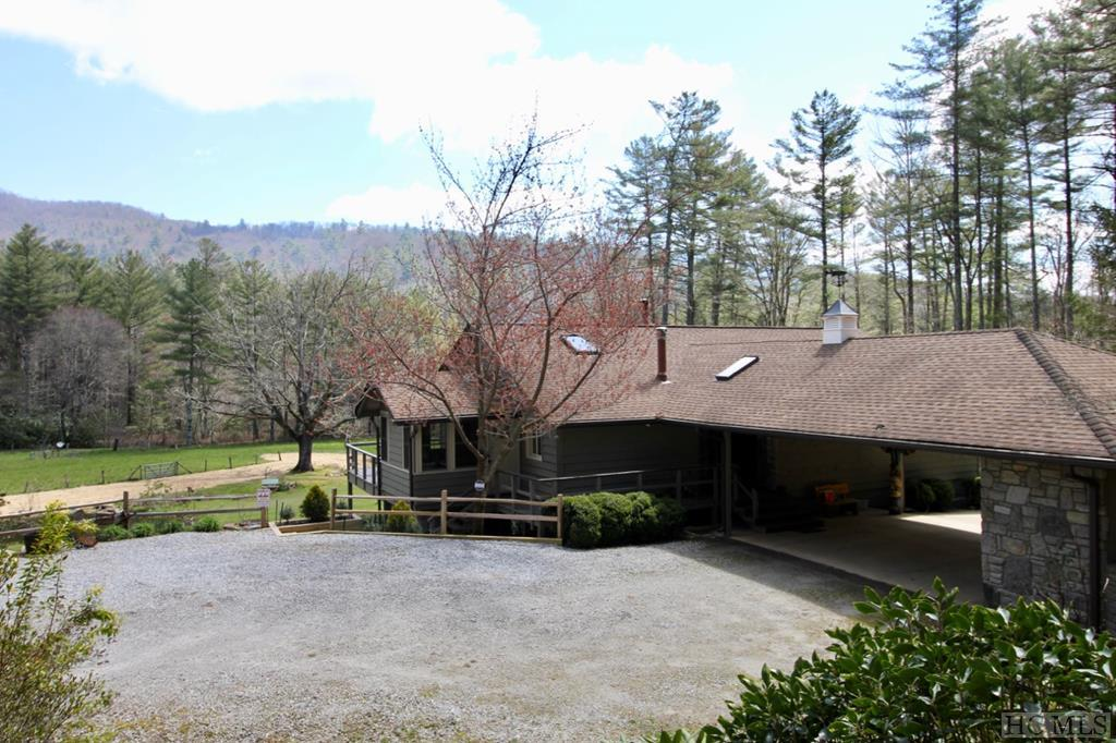 A beautiful country estate on 18 acres with lush rhododendrons and mountain laurel awaits you. Located only twelve minutes from Cashiers, NC makes this an ideal location. The property borders the Nantahala National Forest so you can hike to your heart's content. The flat pasture and corral are perfect to enjoy your horses and ride on your property. There are three ponds ready to be stocked for you to practice your fly fishing techniques. New heat pump and A/C unit, New Kitchen/Granite Counter Tops, New Office and den addition, New hot water heater, New retaining wall, new planter, New pond, Newly updated baths, fresh interior/exterior paint, New ground level patio, new dog lot and Whole House Generator.