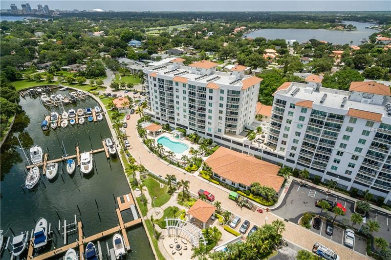 SAFE FROM HURRICANE IRMA! The Water Club survived the 100 MPH winds and heavy rain with strength and elegance. Mother Nature was kept out, while peace was maintained. Seller never lost power and enjoyed the passing of the storm without incident. If you're looking for safety and security in  what can be difficult Florida weather, look no further. This stunning Snell Isle Waterfront Condo has a private elevator to take you home. A large gourmet kitchen with state of the art appliances and expansive granite counter tops flows into a large living area perfect for entertaining. Floor to ceiling windows and doors let in the Florida sunshine in throughout the day. A large private balcony is perfect for coffee in the morning or a glass of wine in the evening. Your master retreat will greet you with the beauty of the sun rising over the water each day. The custom closets and grand master bath can't be beat. A private second bedroom will comfortably accommodate guests. This home also offers a large bonus area with custom built-ins perfect for an office space. The possibilities are endless. The Water Club community offers luxurious amenities. A wonderful pool area, private gym, professional office area, grand entertaining space with a private kitchen for catering. And last but not least, a cozy covered veranda that sits along the waterfront with a firepit. It just doesn't get any better in Florida than that!