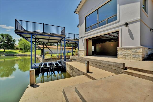 Beautiful Single Story Energy Efficient  ICF New Home in Oakridge/Horseshoe Bay on Lake LBJ.All steel & concrete independently supported boat lift and sitting deck with concrete seawall and poured concrete pad on the Floor of the lake for easy cleaning and maintenance.2 jet ski lifts. Room off of the Boat Deck you can access from inside and outside Awesome big floor plan, Gorgeous Granite in kitchen & bathrooms, oversized garage,craft room/workshop in the utility room.Big Master, W/ a Nice walk in Shower.