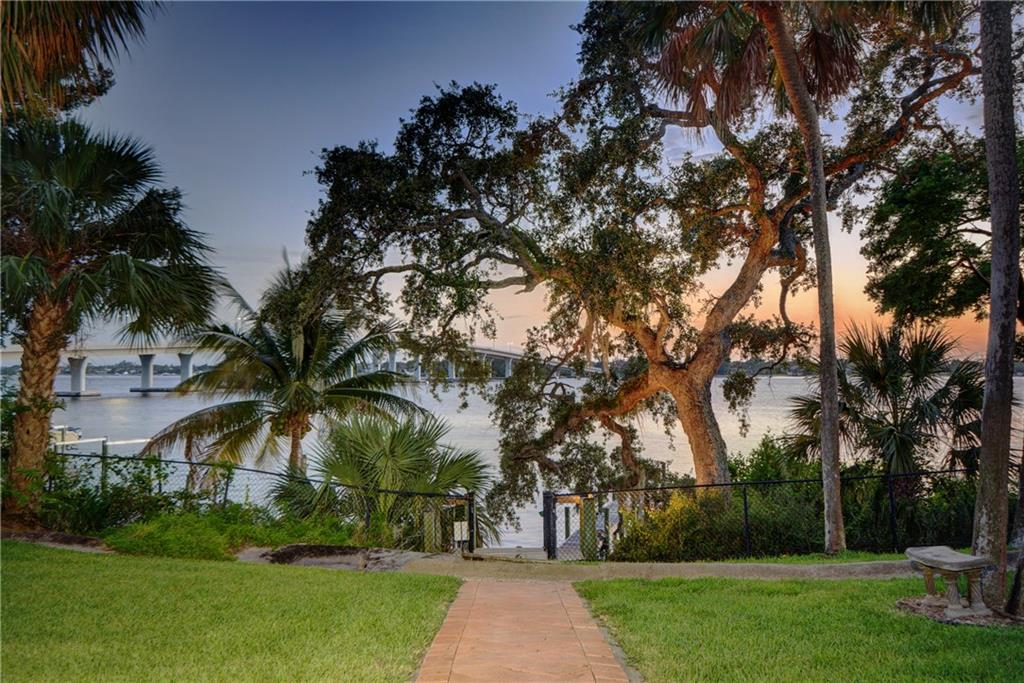 Tropical breezes and stunning views surround this Sewall's Point home perched on 2/3 acre with 20+feet elevation accessing 120' of wide water on the St. Lucie River. Two patios overlooking a beautiful riverside gazebo adorn a lushly landscaped yard with room for a pool. A deep water dock (approx. 4.5' at low tide) that's only minutes to the Inlet add to the perfect waterfront lifestyle. Entertaining almost 3,000 sf of living space under air, this home's relaxed and open floor plan boasts a huge gourmet kitchen with an island and custom cabinets, stainless steel appliances and granite countertops. This home is the least expensive, wide waterfront property in the highly sought-after and prestigious neighborhood of Sewall's Point. This is an oasis enveloped in privacy offering peace and tranquility plus stunning sunsets every evening. Truly a rare find at this price in this exclusive community!