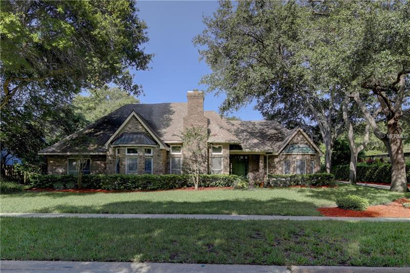 """Desirable Windtree Oaks Neighborhood features this 4 bedroom, 5 Bathroom Pool home on a spacious 110 x 156 lot in Seminole. Built in 1987 and remodeled in 2016/17, you will want to call this home. Enter this peaceful abode with a double-door entry to the master suite to your right, grand salon to your left with welcoming wood-burning fireplace, and a formal dining room with coffered ceiling straight ahead. Designer, gourmet kitchen with 42"""" soft-close, wood cabinets, stainless steel GE Cafe Series Appliances, granite counter tops and island that open to family room and large circular breakfast area that overlooks a serene, screened(2017) pool area with outdoor kitchen and cabana bath. Freshly painted interior enhances all the extra bedrooms that are split from the master for extra privacy. The master bath renovation includes a steam shower, dual shower heads, Rain shower head and Whirl pool tub. Recessed lighting and updated light fixtures(2015/16) More possibilities abound in the In-Law Suite with private entrance, kitchen and separate bedroom for office or work-out area, whatever you need it to be. Easy to show and easy to see why you will want to call this place HOME!"""