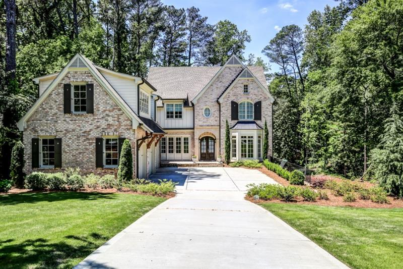 Stunning John Willis newer construction on .68 acres in Buckhead! Gourmet kitchen features high end appliances, custom cabinets, beautiful marble and walnut countertops, oversized island, walk-in pantry, and butler's pantry. Open concept great room boasts extra-high ceilings, fireplace, built-in bookcases, and double French doors leading to covered porch. Formal living and dining rooms are perfect for entertaining. Main level bedroom and bathroom ideal for guests. True mudroom and home management station lead to 3 car garage. Master suite is a true retreat including a fireplace, custom walk-in closet, and luxurious master bath with dual marble vanities, soaking tub, and huge walk-in shower. Additional upstairs bedrooms each have private baths. Laundry up! Private staircase to spacious bonus room with en suite is ideal for playroom, media room, or in-law/au pair suite. Unfinished basement awaiting your ideas! True outdoor living including a spacious covered porch with fireplace overlooking the flat, private backyard ideal for a pool. Amazing location near top public and private schools including Morris Brandon Primary and The Westminster Schools.