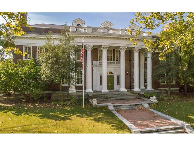 Truly a rare opportunity to own a piece of St. Louis History! Designed in 1912 by renowned architect Theodore Link (designer of St. Louis Union Station), this stately Georgian Revival is an estate like no other. Known as the Rand Mansion, this is one of the most prestigious homes in University City! Boasting 8+ bedrooms, 4 full and 2 half baths, gracious formal living room, elegant dining room, high end gourmet kitchen, conservatory, billiard room, family room, library, main floor laundry and your own private movie theatre! Outside sits a carriage house with a guest suite as well as space for six vehicles. Boasting over 10,000 square feet on close to 1 acre, this unique property holds a coveted title on the National Register of Historic Places.