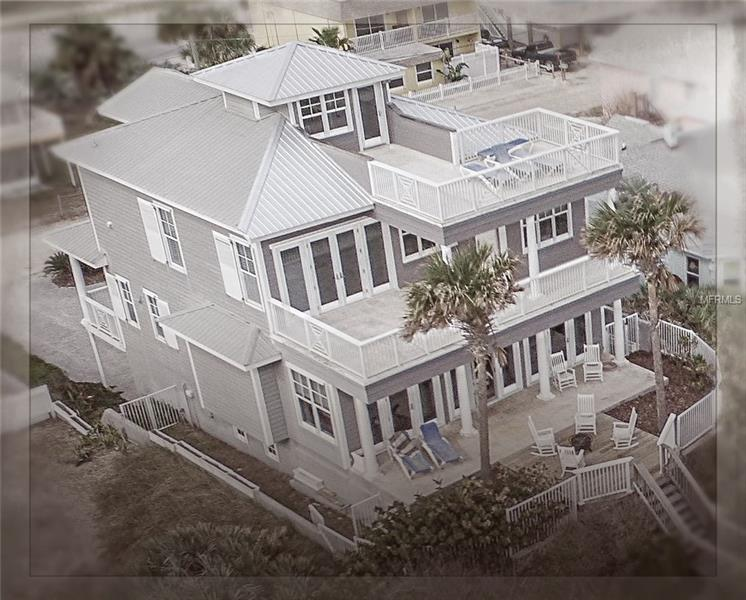 """All decked out!!! A direct ocean-front showplace home set on a premier New Smyrna Beach lot. This home possesses a natural synergy between the architechtural interior & exterior design and handcrafted elements that can only be described as a """"true work of art"""". Unobstructed panoramic ocean views are abundant. The home features an elevator to each of the 4 levels, a wine cellar, & game room/billiards!! The superior craftsmanship is not only evident in the stunning externals, it is truly organic to the whole structure. Solidly built to recent hurricane codes, this home was built to last! Open living area includes a cozy fireplace, wonderful built-in's, one even has an ice maker and keg refrigerator! The inviting, open & bright island kitchen features granite and an extra-large center island that makes entertaining so easy! Dual fuel Monogram gas & electric stove, large stainless steel Monogram refrigerator/freezer. Loads of cabinet space with built-in china hutch. Take the elevator to all four levels - The roof-top deck has amazing panoramic views. There's a raised walkway leading to beach. This enviable & tastefully designed beach home is great for either a relaxing vacation retreat or year round living and available for immediate occupancy... See 3-D Virtual Tour with floor plan. Make an appointment today to view this incredibly gorgeous and well maintained home! Call now."""