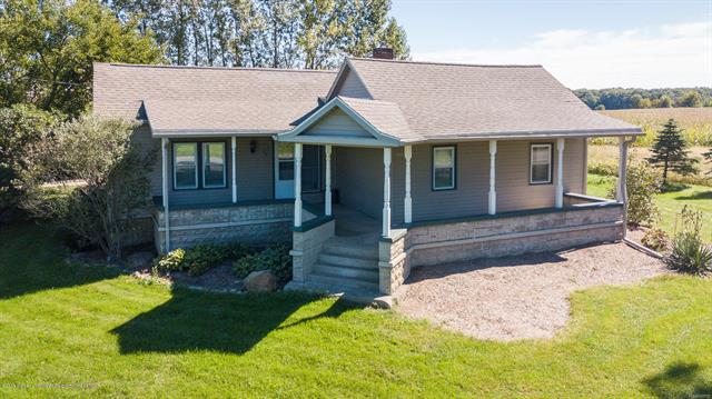 Welcome home to 3993 N DeWitt Rd in St. Johns.  This 3 bed, 2 bath Ranch home is situated on just over 2 acres and features many updates.  Updates include: newer roof, windows, septic system, drain field, furnace, and side deck.  Additional features include; vaulted ceilings, a large kitchen with center island and tons of cabinet and counter space, a wood burning fireplace and bay window with seating in the living room, a two car garage with a 2nd story workshop, nice landscaping, and much more!