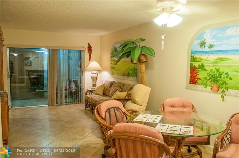 If you are an avid Golfer OR a Race Horse Enthusiast OR a Casino lover, then you cannot pass on this Priced to sell, Seller motivated Remarkable 1st floor lake view condo. Walking distance to Isle Casino & Pompano Race Track, across the street from the Renowned Palm Aire Country Club, minutes to shopping, dining, centrally located between I-95 and the Turnpike. Very well kept. 1st floor units allowed to have a BBQ on the exterior open patio. Catch me if you can, May not be available for long @ this price