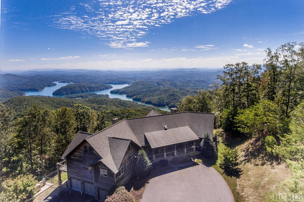Absolutely the Best Mountain/Lake Views in Western NC!..This 6 bedroom, 5.1 bath luxury home built in 2006, offers comfort in an unmatched 2650 elevation mountain top setting with 137 acres. Centrally located from several desirable southern cities (approx. 2 hours from Atlanta, Asheville, Knoxville, and Chattanooga). The WC Regional Airport offers an even closer option for private aircraft owners. Several options are available for new owners including structure in place for additional homesites.