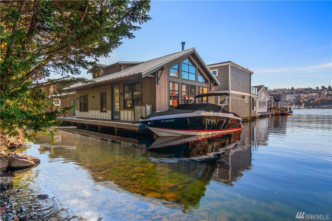 Unbelievably cool floating home remodeled in 2014 using industrial chic materials like stainless and steel. Large windows in living area are topped by beautiful clerestory windows that fill that space with light. Open concept from living, dining and kitchen encourages fun and easy entertaining. Loft space perfect for an added sleeping space or office. Deck on second level allows for great bbq space and beautiful views. Plans and permits are included for installing Nana Doors and deck on north