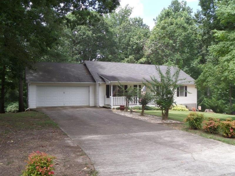 Immaculate home that is move in ready! Features 3 bedrooms/2 baths, fresh paint, new flooring, stainless appliances - including 5 burner gas range with convection oven, rocking chair front porch, back deck, and more. great area in Lula with city water and sewer. 100% USDA financeable.