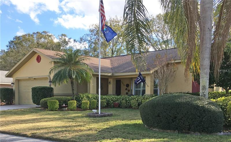 This beautifully remodeled home is in the BEST Over 55 Community in Pinellas County. Ample upgraded wood cabinets with self closing drawers and doors topped with fabulous  granite countertops in the kitchen. Both baths feature top-of-the-line cabinets and gorgeous showers. The inside utility room has plenty of wood cabinets for storage and a convenient sink. The floors are upgraded tile, engineered hard wood and excellent carpet. All windows are newer double pane as are the sliding glass doors that access the screened back lanai.BRAND NEW AIR CONDITIONING SYSTEM WITH ULTRA VIOLET FILTER . Upgrades include beautiful plantation shutters, solar tubes, reverse osmosis and a water softener. You will be proud to own this home which is only a short walk to the Clubhouse, pool and golf courses.   Highland Lakes amenities include newly resurfaced heated and cooled pools and spa, FREE GOLF on the 3 beautifully maintained executive golf courses, tennis, pickleball, bocci, shuffleboard and pool tables are available. At the very active clubhouse find shows, dances, cards and crafts, a well-equipped wood working shop, numerous classes and activities. Amenities also include FREE pontoon boat rides on Lake Tarpon as well as RV and Boat Storage on a space available basis. ALL THIS AND MORE FOR ONLY $98 PER MONTH HOA FEE.