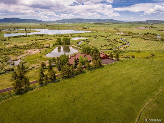 Flowing Waters Ranch is a recreational paradise situated on approximately 111 prime acres in the south valley of Steamboat Springs. Owners have access to approximately ¾ mile of the Yampa River, which delivers some of the best fly fishing in Colorado. It traverses its way through the heartland of this property where east meets west & reveals a unique, multi-generational property offering not one, but two luxury residences- each with detached caretaker homes!  The Ranch showcases a premier equestrian facility with an indoor riding arena. Various water rights are included with this property. Both residences have experienced substantial cosmetic renovation in the past year or more, enhancing the farmhouse and/or mountain contemporary themes of the homes. Rarely does a location like this come on the market where one can live a ranch lifestyle that is < 6 miles from the ski area or 3 championship golf courses & just minutes from downtown, snowmobiling & more! Visit FlowingWatersRanch.com