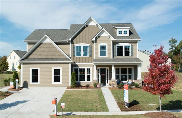 NEW designer home located in the amenity filled Lake Ridge community of Tega Cay. The Drake is a 5bd/5bth