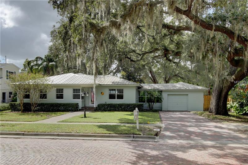 This home is the best of Old Florida, but completely updated inside and out. Right in the beautiful, quaint community of Dunedin - nationally recognized as one of the best small towns in America - is this charming 3 bedroom, 2 bath home with the soul not found in newer communities. This style of home inspired thousands to give up the snow and move here to fish, golf and watch the sunset, but every detail has been updated to the conveniences of 2017. The gourmet kitchen is complete with all top of the line GE Monogram appliances, stainless steel farm sink, gas cooktop, huge island w/ vegetable sink and white custom cabinets. The updates don't stop in the kitchen with crown molding throughout entire home, every window w/ custom wood casing, all new paint inside and out, brand new tankless hot water heater, beautiful red oak hardwood floors throughout every room and all updated plumbing and electrical all the way to the street! Large master retreat with spacious walk in closet w/ custom shelving! The driveway, leading to the garage, and the front walk way are newly laid custom brick pavers. The home sits on an oversized lot surrounded by majestic oaks! Enjoy the weekends in the custom built outdoor kitchen with brand new stainless steel grill! Completely renovated from the roof to floors, this Dunedin delight won't disappoint the most discerning of buyers! This perfect combination of the charms of the past and the amenities of a newer home, this one is a must see!