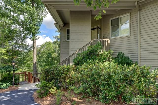 Price reduction of $20,000.00. Seller is motivated to sell !!Find your mountain retreat nestled in a cool, wooded setting, dense with native hardwoods and all of the modern-day luxuries you would expect to find in a high-end condominium. This 3 bedroom, 3 bath condo features a floor plan that is all on one level and has hardwood floors throughout. Experience the best of all worlds: maintenance-free living, secluded location with captivating golf course views, and close proximity to the prestigious Old Edwards Club.Take advantage of the beautifully decorated screened porch or open deck to view the sun as it rises and sets in the midst of multiple mountain ranges. Additional features in this stunning condo include ten-foot ceilings, a stacked-stone fireplace, wet bar, and whirlpool tub. Come see our magnificent community and find your home on top of the world! Offered furnished with very few exclusions!
