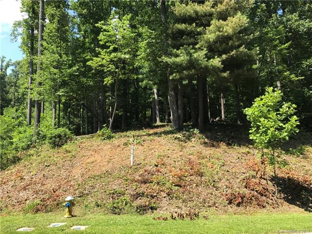 One of the flattest, builder and budget friendly lots in Kenmure. Lot has active septic permit, is ready to build upon and has a privacy screen of tall Leland cypress trees along Pinnacle Mountain Road.   A very good value and a builder - consultation can be arranged with one of the Kenmure on - site agents.   Please call to arrange to consult with a builder familiar with Kenmure (square footage minimum is 2,200 for a  one - level home on a crawlspace) and on - site agents can assist.
