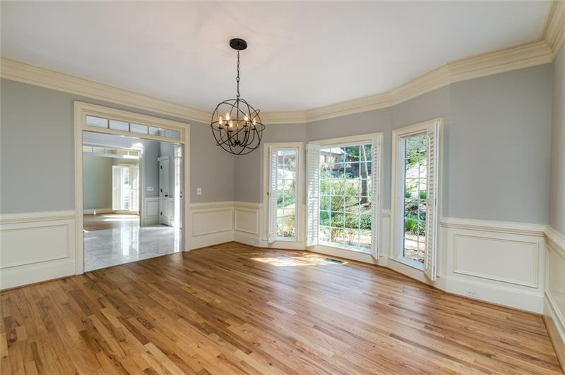 Gleaming marble floors, stunning transoms, large palladium window & custom chandelier welcomes your family & friends as they enter this stunning home!