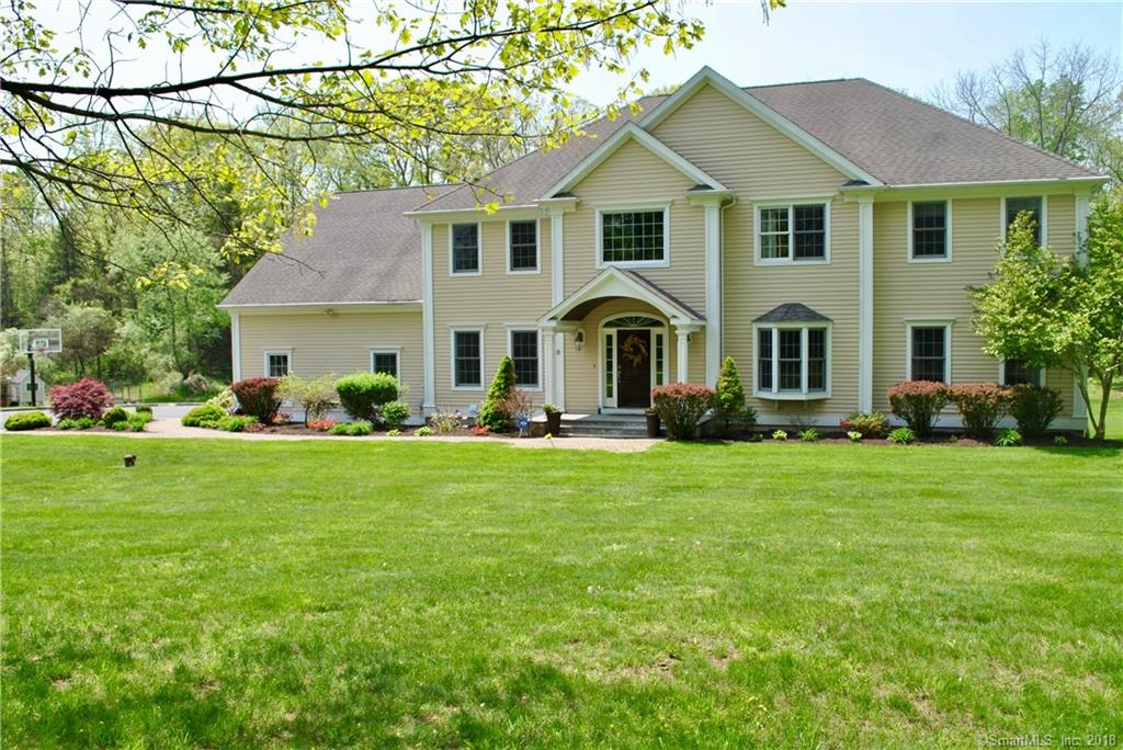 Are you looking for a Town that offers great schools, friendly people and easy access to top notch restaurants, museums, live theater, music venues, art shows and farm to table events?  Take a look at Redding.  Centrally located on a quiet cul de sac, close to schools and minutes from Georgetown and Ridgefield, this lovely home is a must see.  Fabulous open floor plan perfect for entertaining.  The stone FPLC is the focal point of the Great Room, the gourmet Kitchen w high end appliances, center island and seating area opens to the Great Room.  A formal dining room, living room, dramatic 2 story entry foyer, updated powder room and laundry room complete the first floor.  Bedrooms are large with good closet space.  1 ensuite bedroom w walk in closet, 2 bedrooms share  a Jack and Jill Bathroom and a Master Suite with his and hers walk in closets are all on the second floor.  There is an additional 600+ sq footage in finished walk out lower level featuring a sitting area that opens to its own patio, media/game room, Rec room and additional room with a closet and full bath perfect for home office, study, guest room, au pair or in law suite.  Enjoy the expansive flat property and views of open space sitting on the deck or patio plus private playground on the property perfect for kids of all ages.  Minutes from Metro North Station, easy drive to I84 and Route 7.
