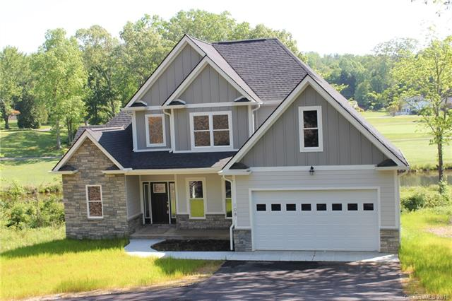 New construction, 3BR, 2.5 baths, 2 car garage, open floor plan, beautiful kitchen with stainless steel appliances & granite countertops.  Hardwood throughout main level. Master on main with trey ceiling, huge walk-in closet and master bath with vaulted ceiling.  Upstairs there's two spacious bedrooms, full bath and bonus room.  Huge back deck looking down on the 9th hole of Etowah Valley Golf Course.  Need more space?  Full unfinished basement that is framed, plumbed and ready for expansion.  Great location, easy drive to Hendersonville, Brevard or Asheville.  And, you can walk to the clubhouse for your next round of golf!  This one will not last long.