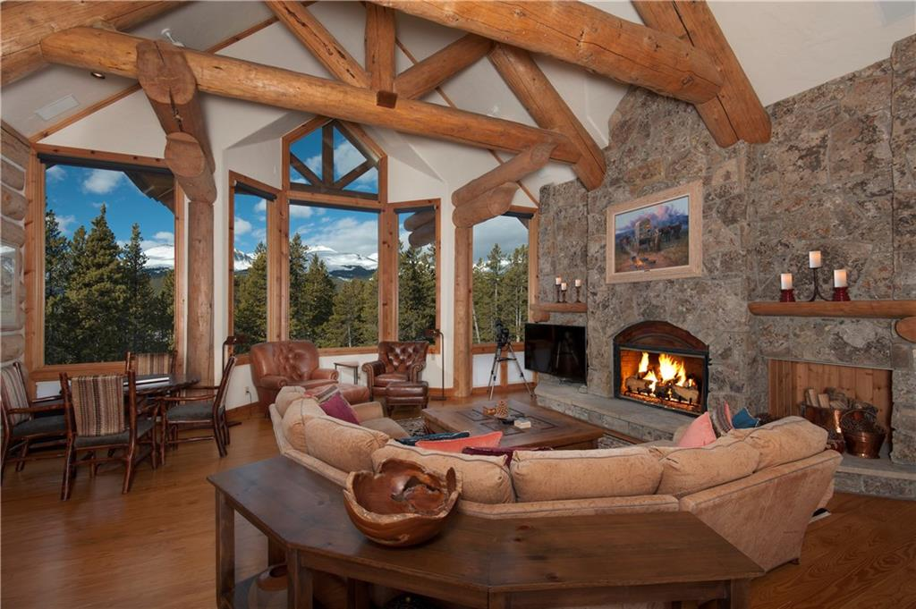 Spectacular COLORADO home is the ultimate lodge in the mountains. Panoramic mountain views. All day sun. Log trusses, stone floors, granite & copper counter tops, the details are too numerous to mention.Might be THE best Gunson design in Spruce Valley Ranch. Ranch amenities include private stables, tennis court, boat house, trail system, skeet range and more. Current owners improved it with new gym and garage. Now the ultimate family magnet. 5 minutes from downtown; in better than new condition.