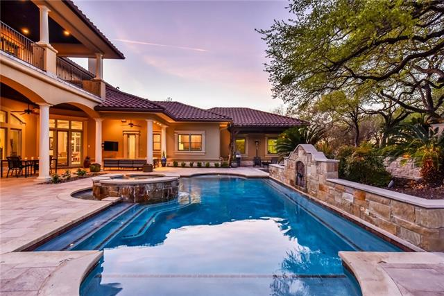 Assessed at over $2.5 mil. Stately home in gated Lake Travis WATERFRONT COMMUNITY! Boat slip conveys giving instant access to Lake Travis! Set elegantly on 1.3 usable acres, this home has been transformed with an updated color scheme throughout! Main level master + main level guest quarters. 2nd Master suite upstairs. Enchanting wine room and peaceful outdoor oasis by the sparkling pool! Sq. ftg includes large bonus room over the additional detached garage! 5 total garage spaces. Pre-inspected and ready!