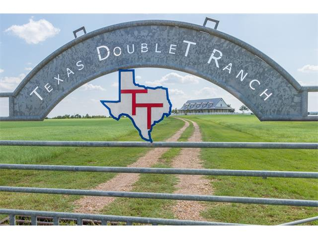 295 Acres with 3 amazing custom homes! Sprawling views for miles. Make this your dream ranch or your next land dev. opportunity with unlimited possibilities. Conveniently located 1.5 miles off US 290 in between Austin & Houston & 15 miles from Elgin, Bastrop, Smithville, & Giddings. 45 min to ABIA airport. Main house has 7 beds, 4.5 baths, 3 car attached garage & adjoining sunroom leads to MIL house with 2 beds & 1 bath. Guest/rental house has 3/3/3. Seller is willing to sell 200 +/- Acres separately.