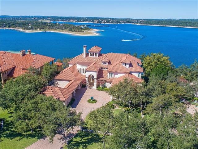 The pinnacle of Lake Travis living, extensively updated, perched high on the lake with 2.8 acres. Soft white modern interior rooms are bathed in natural light and combine with the blue hues from the water beyond to create a tranquil and inviting spaces. Terraces provide remarkable views across the negative-edged pool/spa and lawn out to beautiful sunsets over the lake and hills beyond. Al-fresco dining and cooking opportunities. Large boat dock with boat and ski lifts.