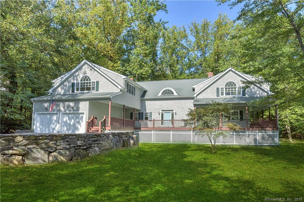 Best deal in Darien!  Framed by stone walls, this spacious 4-5 BR colonial is graced by soaring ceilings & a wall of windows overlooking the private backyard. The entry foyer draws you in to dramatic vaulted ceilings & a layout made for entertaining.  Beautiful hardwood floors & plenty of natural night flow throughout the home. Other special highlights include 4 fieldstone fireplaces on the 1st floor w a 5th fireplace in the MBR. The 1st floor offers a formal LR, Formal DR, Family room, eat in kitchen w fireplace, huge library/den, mudroom & powder room.  Many 1st floor spaces flow outside to the outdoor wrap around deck. The generously sized master suite features vaulted ceilings, fireplace, balcony, walk in closets & large bath. Huge bonus room can be divided to fifth BR. 2 car garage. Tokeneke School.