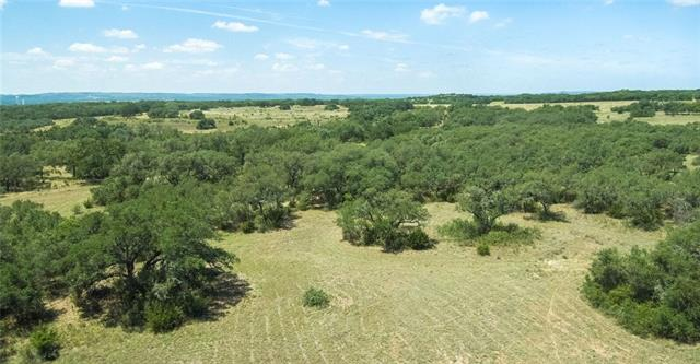 This 12.5 acre tract offers a private building site surrounded by mature Oak trees. The property is well suited for a boutique vineyard or orchard minded Buyer. Basically level terrain, little slope toward front property line along Hwy. Partially high fenced along 2 sides (South & East) A gate has been installed after visiting w/TXDot, driveway/entrance from property to Hwy required. PEC electric available, WL exempt, annual POA dues $100, BCAD taxes $17.85 more acreage available see Lot 3A (12.5 AC)