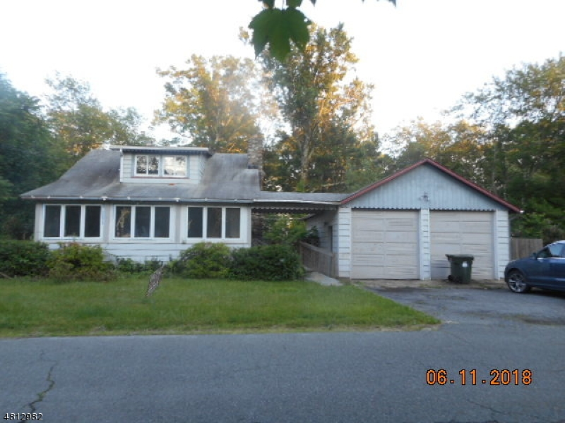Cape cod/Colonial style 2 bedroom house on a quiet residential street easily accessible to major commuter routes , local shopping and nearby Budd Lake for recreation. Large detached 2 car garage is a huge bonus.