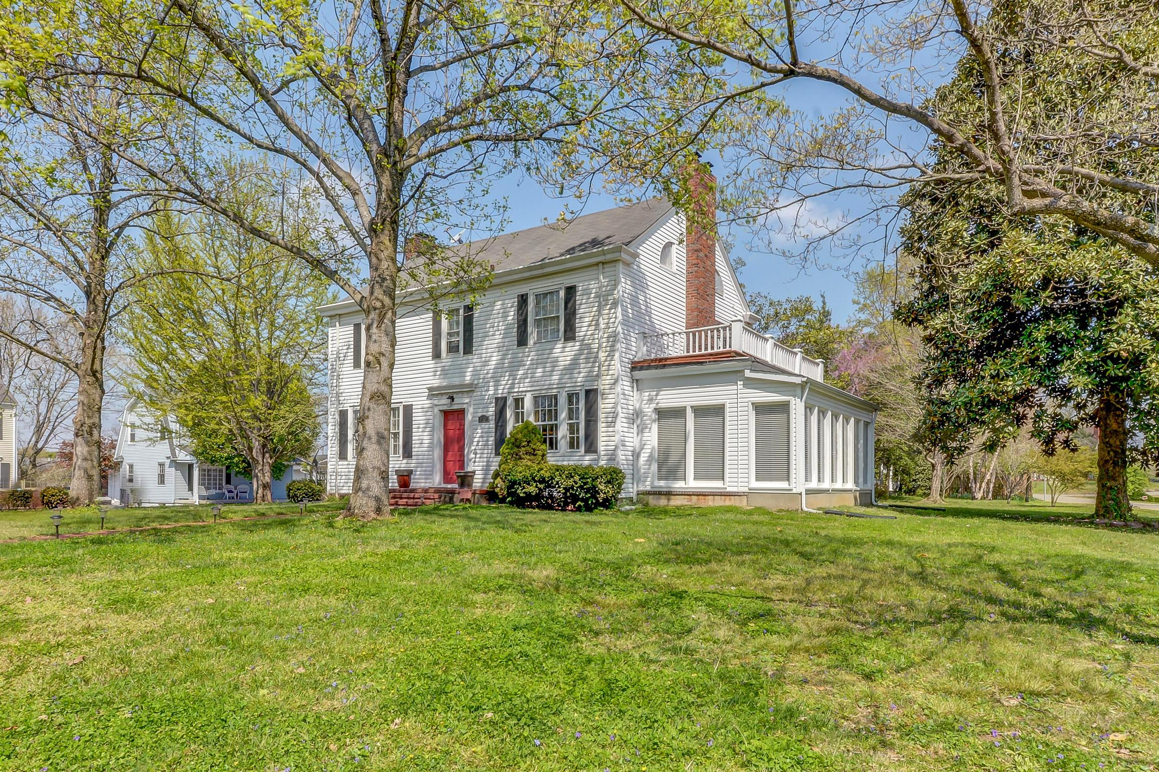 This 1930 Colonial is the ultimate in lovingly restored historic charm. Directly across from Old Hickory Lake with a sweeping view, this incredible 3-story home has updated kitchen, baths & more, without sacrificing historic character. Short walk to Marina, restaurants, trails, parks. Quiet community, easy commute to Nashville. Must see!!