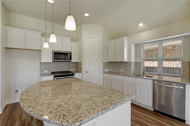 Stunning Maybeck II floor plan, with beautiful finish out, now move-in ready! Open concept floor plan features a spacious master on the main floor with an office or 5th bed, 2 add'l bedrooms on 1st floor.  A gourmet style kitchen boasts large granite island with SS pendant lighting & walk-in pantry. Gameroom and bedroom w/ full bath up! Dramatic rotunda entryway, ample natural light, office, covered back patio, sprinkler, stainless appliances and more upgrades!