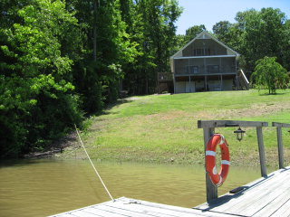 Own all the way to the water on Kerr Lake a rare find.You have a wonderful view with a gentle slope to your dock. This home has it all:Perfect view, protected cove,large screened porch with ceiling fans,4 bedrooms, 2 baths,great room with gas fireplace and handicapped accessible. Home has a proven rental history. This would make a great vacation, retirement or investment property.Furniture Conveys.