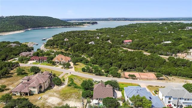 This Gorgeous property is waiting for you to embark on the lake life. This Gorgeous property is waiting for you to embark on the lake life. Minutes from Volente Beach resorts, Lake Travis zip line, Lake Travis Waterloo and walking distance from Riveria Marina. Low key landscaping with peaceful views and hummingbirds galore make the front yard a peaceful place for morning coffee, then head to the back for BBQ's while cooling off in the pool. Stunning floor plan with beautiful tile and natural light.