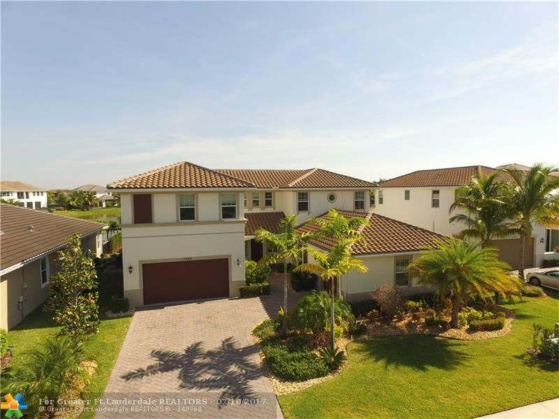5 Bedroom, 4 1/2 Bath, 3 Car Garage waterfront home in Sawgrass Bay at Heron Bay. This beautiful home features over $100,000 in upgrades, including; marble & wood floors, upgraded kitchen counters, cabinets & appliances, extended patio, upgraded bathrooms. Hurricane Impact Windows and Doors. Guard gated community with 2 clubhouses, tennis, golf, resort style pool, playground, tennis, splash park plus many more amenities. Top rated Broward County schools. Close to highways, shopping, & restaurants.