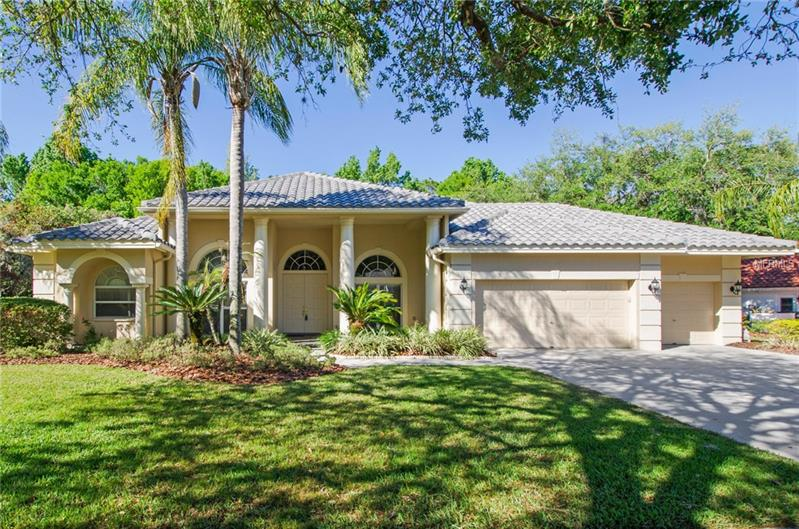 """Exceptional find in the heart of Tampa Palms! This stunning home offers 4 bedrooms, 3 baths, office and 3 car garage. Completely remodeled with high end finishes and located in the gated village of Westover, this is the house you'll want to call home. Built by Hannah Bartoletta Homes with almost $200k in upgrades that include; NEWER TILE ROOF, A/C, EXTERIOR PAINT, REMODELED KITCHEN, BATHROOMS, PEBBLETECH POOL and more. You'll fall in love with the remodeled chef's kitchen! Boasting 42"""" custom cabinetry, glass subway tile backsplash, granite counters, stainless steel counter depth refrigerator, induction stove, convection oven, Advantium oven, wood paneled vent, drop pendant lighting, LED under mount lighting and high top bar. The family room blends classic elegance with contemporary lines featuring travertine trim around fireplace, soaring 12 ft. ceilings, gas fireplace, new carpet and 8 ft. sliders to the lanai. The office has built-in custom cabinetry, distinctive wainscoting and custom window treatments.  Relax at the end of the busy day in the sun filled master retreat.  The master bath was remodeled in 2018 with new solid surface counters, sinks, faucets, wall mirror and has a separate shower and garden tub. You'll love lounging along the renovated salt water pool! It's been refurbished w/new Pebbletech finish and surrounded by a pavered lanai with new screens. Ask for complete list of upgrades. Walking distance to Publix and just minutes to I-75, USF, Moffit, A rated schools and Regional Malls."""