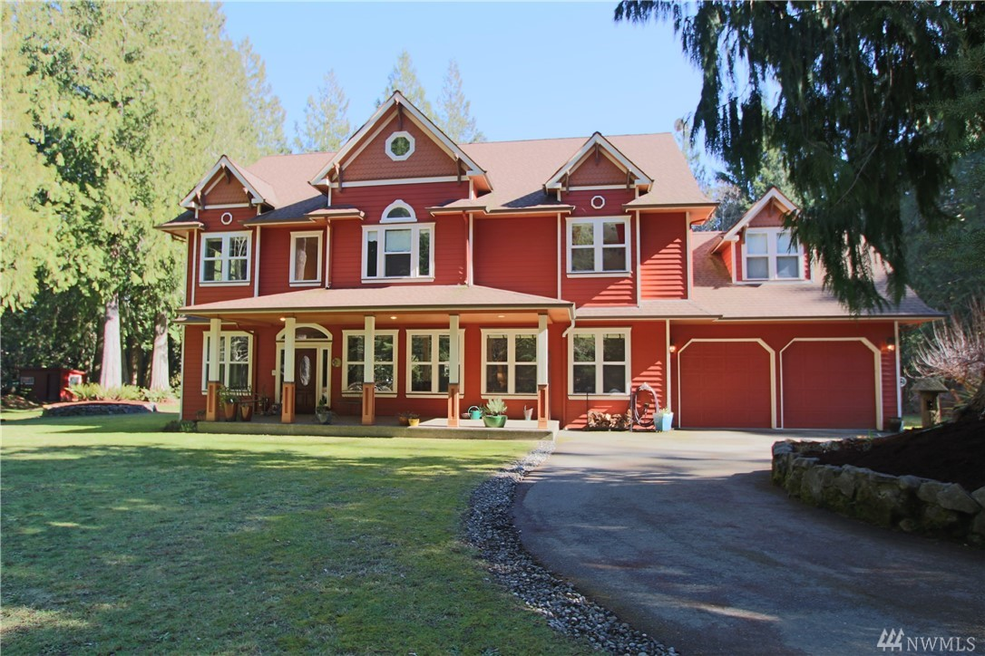 Magnificent Estate situated on over 6 acres of woods perfect for anyone looking for a quietly classic home surrounded by nature. Salmon bearing stream gurgles through the property. The floor plan allows for numerous sleeping arrangements including 2 masters. An enchanting retreat for gatherings & an inspiring setting to unleash your creativity. Detached studios plus a shop with room for 2 RVs. All this & a swimming pool too. Live your dreams in this magical sanctuary for many years to come.