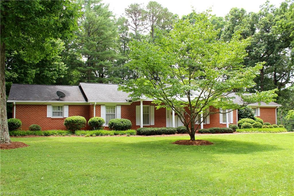 Elegant brick ranch in one of Mount Airy's most established neighborhoods. Very good condition 3 br/2 bath large brick ranch with basement and 2 car open carport that could be garage easily if you add a garage door. Home boasts a large great room with fireplace and separate den with dining room.  Bedrooms also are fairly large, has screened back porch and basement playroom with fireplace.  Great location and on a corner lot.