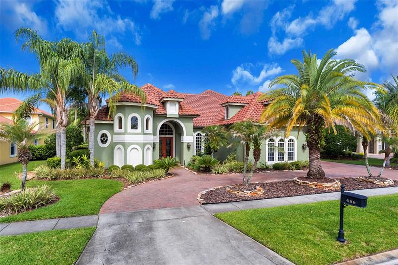 NEW PRICE OFFERED!! Luxury Living in Lake Mary!! This Stunning Golf & Waterfront Custom Tuscan Home has Upgrades Galore! This Hillcrest home sits on just under a half an acre in guard gated golf neighborhood Magnolia Plantation. Home's newly painted exterior features circular driveway and ample parking  With all of the custom finishes, there is still plenty of room to make this home your very own! The fully equipped Chef's kitchen will make meal prep a breeze.  The downstairs master boasts a spacious walk in closet, along with his and hers vanities.  There are two additional bedrooms & a guest suite on first floor. Upstairs an office with custom furnishings and theater room complete the upstairs.  With more than enough space for entertaining or relaxing, enjoy a movie at home on a quiet evening, or take in the beautiful views of the 18th Fairway and pond from the upstairs wraparound balcony.  Located close to I-4 and 417 as well as minutes from Downtown, you'll be able to get wherever you need to quickly.  There is plenty of shopping and excellent schools within minutes.  This home will NOT last so make it yours TODAY!