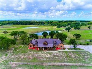 Long Road Ranch - Stunning mile long views & 4/10 mile of the San Gabriel River meanders throughout. Stone home overlooks 1 acre lake.For equine enthusiasts - a 7,100 sq. ft. 8 stall barn of matching craftsmanship, impeccable stalls, wash racks, saddle room, living quarters, office & excellent turnouts. For auto or equipment enthusiasts there is a stone garage, 8 station sporting clay stand, & outdoor pits for cooking finish off this property for an all inclusive retreat in the heart of Williamson County.