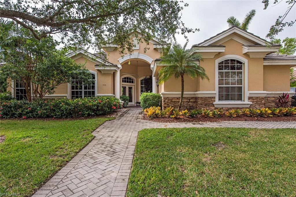 Very private lot in Fiddler's Creek.  Move-in condition. Furniture included, 5 bedrooms, 3 baths, 3 car garage, tile throughout, tray ceilings, planation shutters, on a much south after street.  Membership in Fiddler's Creek and Spa-a World Class Resort!