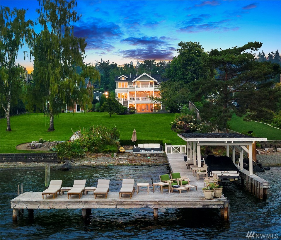 A rare offering for the waterfront buyer who has patiently been waiting for an exceptional, historic Gold Coast property to present itself. Located in the most desirable neighborhood and street on the westside of Mercer Island.  Includes sweeping, year-round, lake, city and mountain views. This home provides an annual center court, front row seat to the Blue Angels show. Timeless architecture, design, high end appliances. Rare flat access, no bank waterfront with a boat & jet ski lift. Must see!