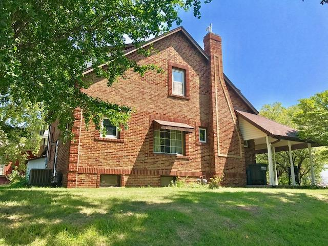 Here is a Beautiful Brick Tudor style home that is priced to sell! This home has many updates! 3 bedrooms, 2.5 bath, with a single car garage! The large living room has a fireplace, open kitchen with dining area.  The home has very large windows which adds to the character of the home.  The large master bedroom has high vaulted ceilings, a walk out deck , and a master bathroom that includes a jetted tub!  The basement is set up to have a game room or theater room.