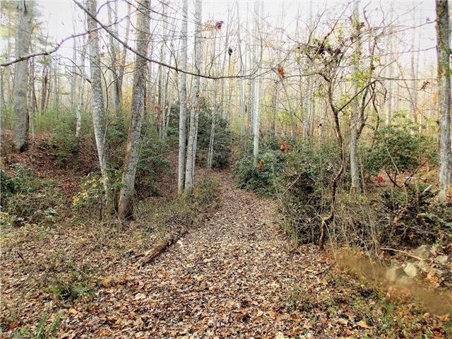 2.63 Acres off Brookgreen Lane in Skyview Estates. Nice established area convenient to Hendersonville.  Private wooded  setting with small stream on property.  Culvert inplace...with easy walking access to nice building site. Old septic permit has expired - new permit will need to be obtained.  Legal descriptions and taxes are for two parcels.