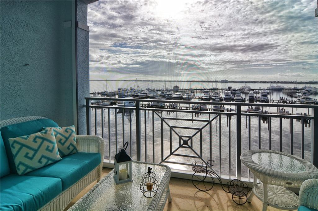 Stunning panoramic, unobstructed view of the St. Lucie River in this desirable penthouse condo. Features such as Travertine marble flooring, granite kitchen counter tops, stainless appliances, in-unit washer/dryer, huge master suite and bath and private guest suite with bath, screened private balcony, to name a few. Under building reserved parking space with remote gate entry. Close to the Yacht Club or easy walk to downtown Stuart for entertainment, dining and shopping. Yacht Club features fitness center with sauna and steam rooms, pool side patio grill, restaurant and bar and full service marina to accommodate 100' plus vessels. Water and sewer included in rent plus basic cable. Tenant pays electric and responsible for minimum food and beverage at Yacht Club restaurant of $100/month.