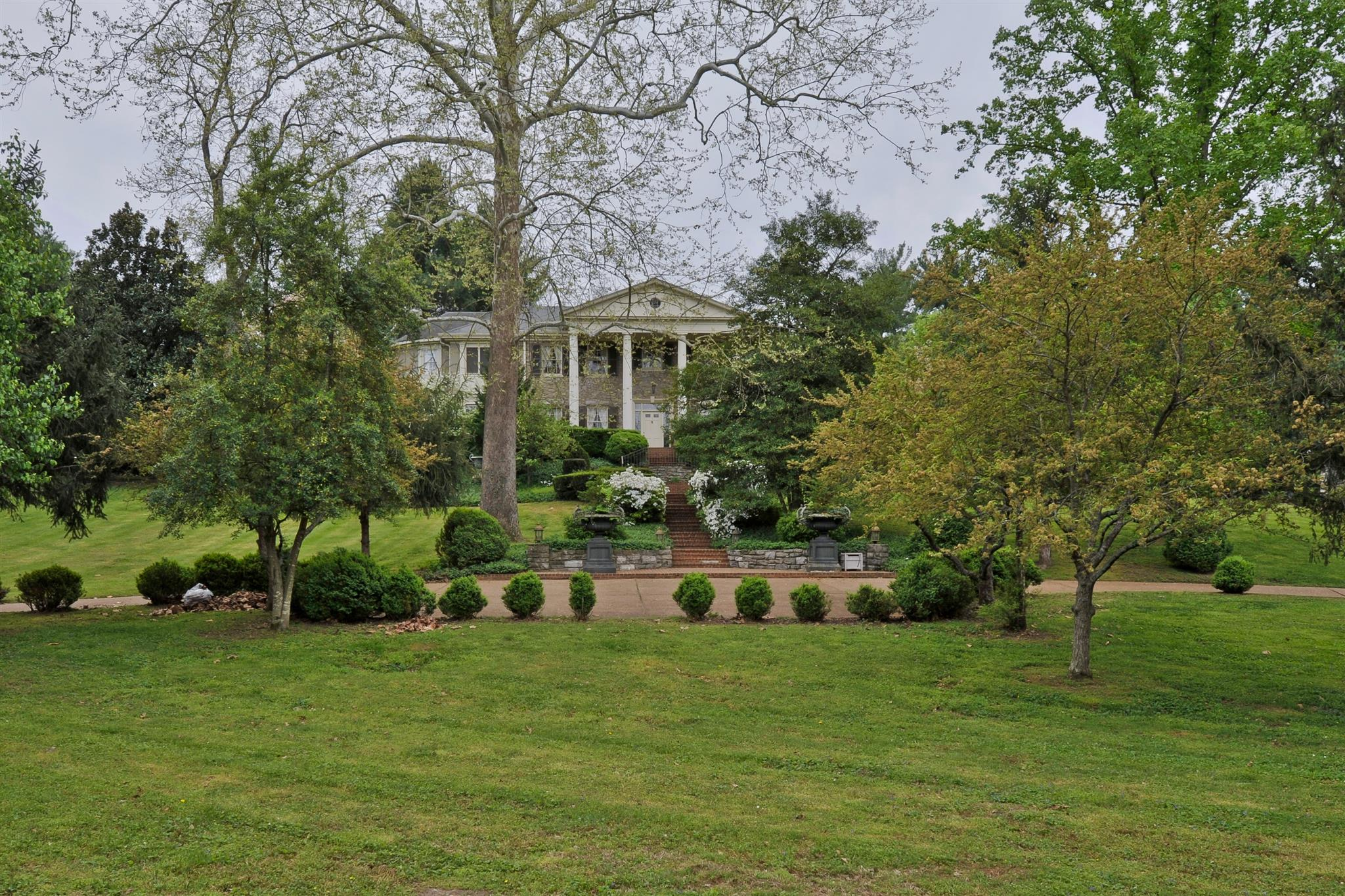 """Rare opportunity. """"Walnut Hill"""" estate features large stone home w/original hwds, mantels, & more on 21/2 lush acres w/ pool, pool hse, tennis/sports court. Banquet sized rooms flow easily for fantastic entertaining. Gorgeous views out every window."""