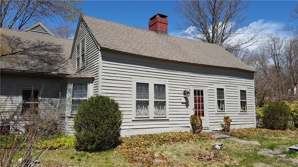 """Wonderful Antique with several additions. Some deferred maintenance. Sale """"As Is"""". Beautiful 7+ acres with multiple impressive gardens."""