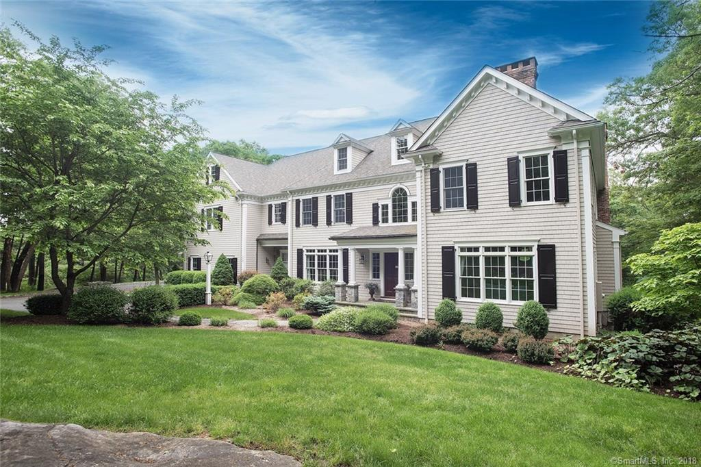 "This stunning home is beautifully sited on lovely level property, on a designated ""scenic road"" in prime south Ridgefield location. Built with flawless attention to detail by premier builders, Sturges Brothers, this elegant, yet comfortable home boasts a classic colonial flow with special touches such as extensive custom trim, millwork and built-ins. Comprising the first floor are formal living and dining rooms with a wet bar service area, a well-appointed study, a spacious kitchen open to a family room with coffered ceiling.  Highlights on the second floor include a master bedroom suite with sitting room, three additional en suite bedrooms and an upstairs bonus room.  Perfect for entertaining, the finished 1,100 square foot walk-out basement includes a media room and gym.  Additional features are upstairs laundry room with custom storage, three gas fireplaces, Viking professional series appliances, closets galore and walk-up attic with ""finishable"" area.  Outside, privacy abounds as French doors open to a stone patio, heated spa and expansive back yard.  Convenient to Route 7 (1.5 miles) and Main Street (2.0 miles), this turn-key home is perfection."