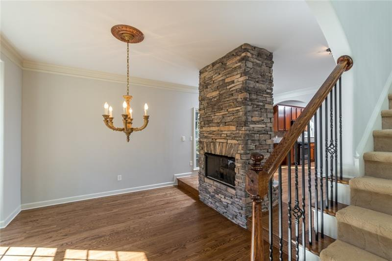 What in impression as your guests enter your home! Amazing two sided fireplace gives the perfect focal point for the formal dining room or sitting area!